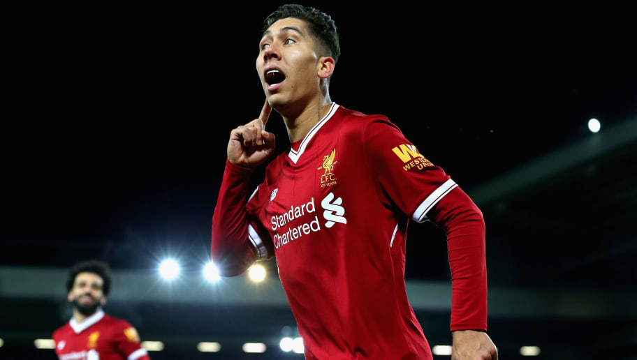 LIVERPOOL, ENGLAND - DECEMBER 26:  Roberto Firmino of Liverpool celebrates after scoring his sides second goal during the Premier League match between Liverpool and Swansea City at Anfield on December 26, 2017 in Liverpool, England.  (Photo by Jan Kruger/Getty Images)