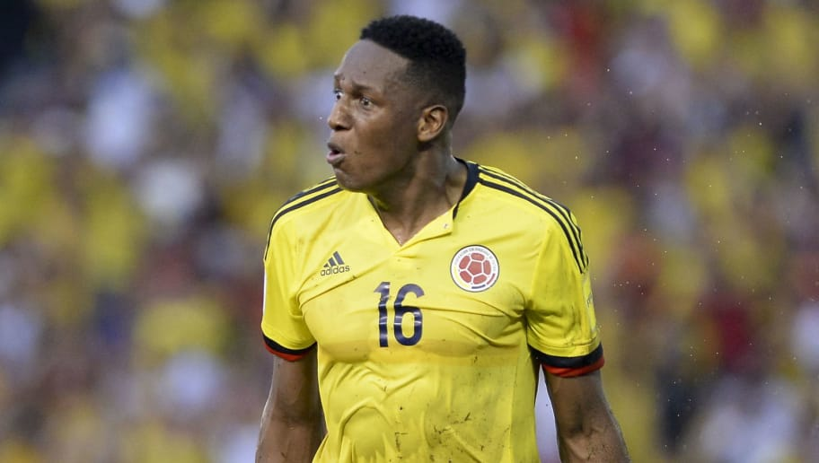Colombia's defender Yerry Mina celebrates after scoring against Uruguay during their Russia 2018 World Cup qualifier football match in Barranquilla, Colombia, on October 11, 2016. / AFP / Raul Arboleda        (Photo credit should read RAUL ARBOLEDA/AFP/Getty Images)