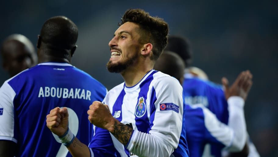Porto's Brazilian defender Alex Telles celebrates after scoring a goal during their UEFA Champions League group G football match FC Porto vs Monaco at the Dragao stadium in Porto, on December 6, 2017. / AFP PHOTO / MIGUEL RIOPA        (Photo credit should read MIGUEL RIOPA/AFP/Getty Images)