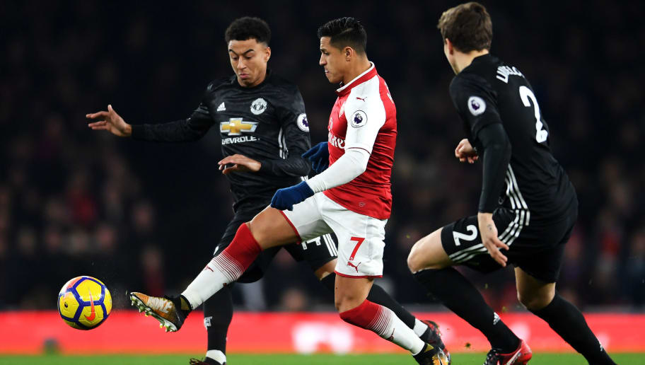 LONDON, ENGLAND - DECEMBER 02: Alexis Sanchez of Arsenal is challenged by Jesse Lingard of Manchester United during the Premier League match between Arsenal and Manchester United at Emirates Stadium on December 2, 2017 in London, England.  (Photo by Laurence Griffiths/Getty Images)