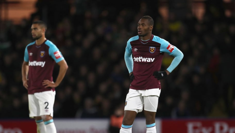 WATFORD, ENGLAND - NOVEMBER 19:  Diafra Sakho (R) and Winston Reid of West Ham United look dejected during the Premier League match between Watford and West Ham United at Vicarage Road on November 19, 2017 in Watford, England.  (Photo by Catherine Ivill/Getty Images)