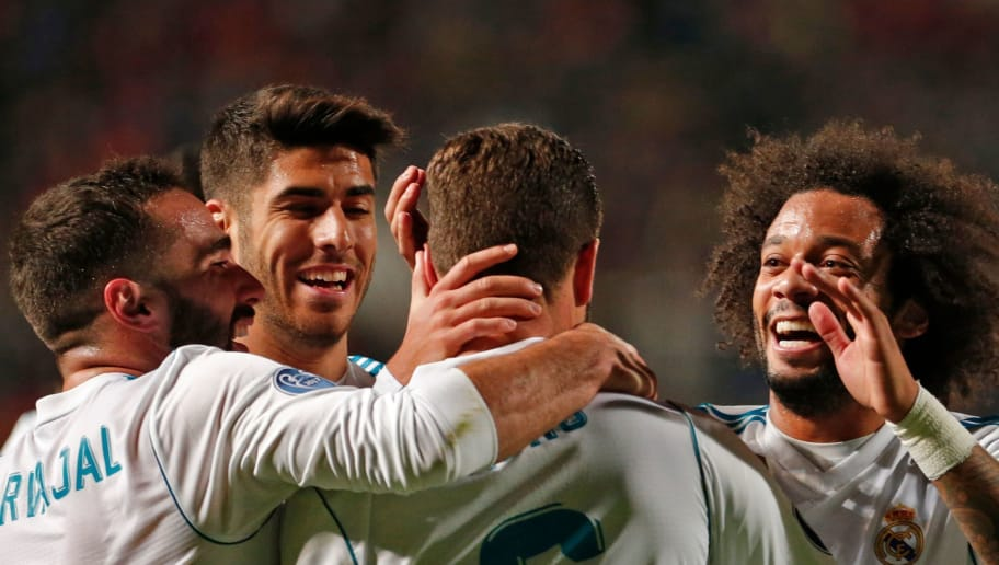 Real Madrid's Spanish defender Nacho (C) celebrates his goal with Spanish defender Dani Carvajal (L), Spanish midfielder Marco Asensio (C-L), and Brazillian defender Marcelo (R) during the UEFA Champions League Group H match between Apoel FC and Real Madrid on November 21, 2017, in the Cypriot capital Nicosia's GSP Stadium.  / AFP PHOTO / Florian CHOBLET        (Photo credit should read FLORIAN CHOBLET/AFP/Getty Images)
