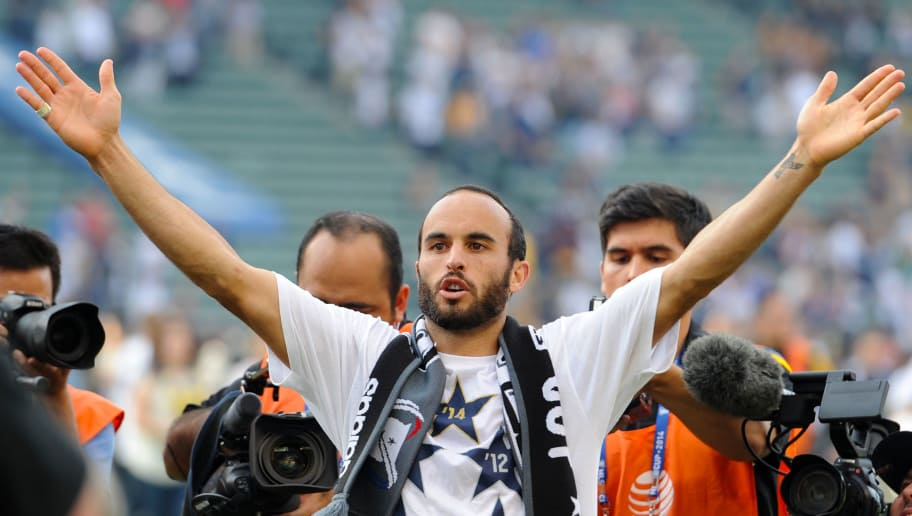 LOS ANGELES, CA - DECEMBER 07:  Landon Donovan of the Los Angeles Galaxy does a lap of honor to salute the fans after the Galaxy defeated the the New England Revolution during the 2014 MLS Cup match at the at StubHub Center on December 7, 2014 in Los Angeles, California.  (Photo by Robert Laberge/Getty Images)