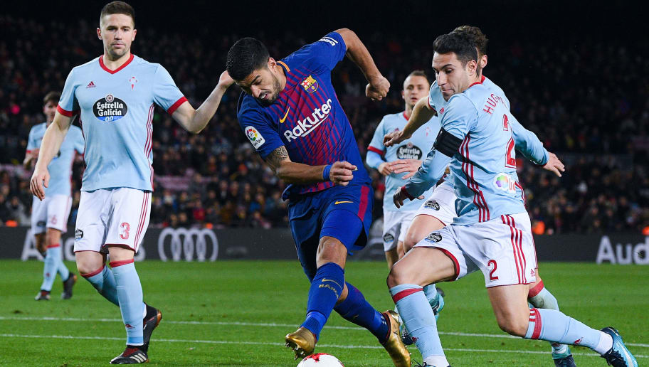 BARCELONA, SPAIN - JANUARY 11:  Luis Suarez of FC Barcelona competes for the ball with Celta de Vigo players during the Copa del Rey round of 16 second leg match between FC Barcelona and Celta de Vigo at Camp Nou on January 11, 2018 in Barcelona, Spain.  (Photo by David Ramos/Getty Images)