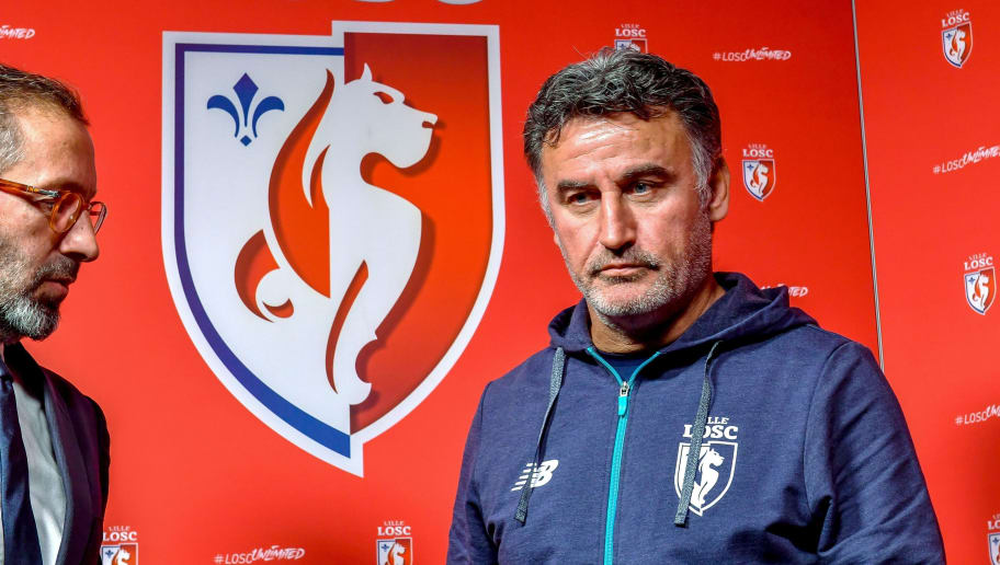 Lille's new French headcoach Christophe Galtier (R) poses next to Lille's general manager Marc Ingla at the training centre of French L1 football team Lille OSC (LOSC) following a press conference on his presentation at the Domaine de Luchin, in Camphin-en-Pevele, northern France, on December 29, 2017. / AFP PHOTO / PHILIPPE HUGUEN        (Photo credit should read PHILIPPE HUGUEN/AFP/Getty Images)