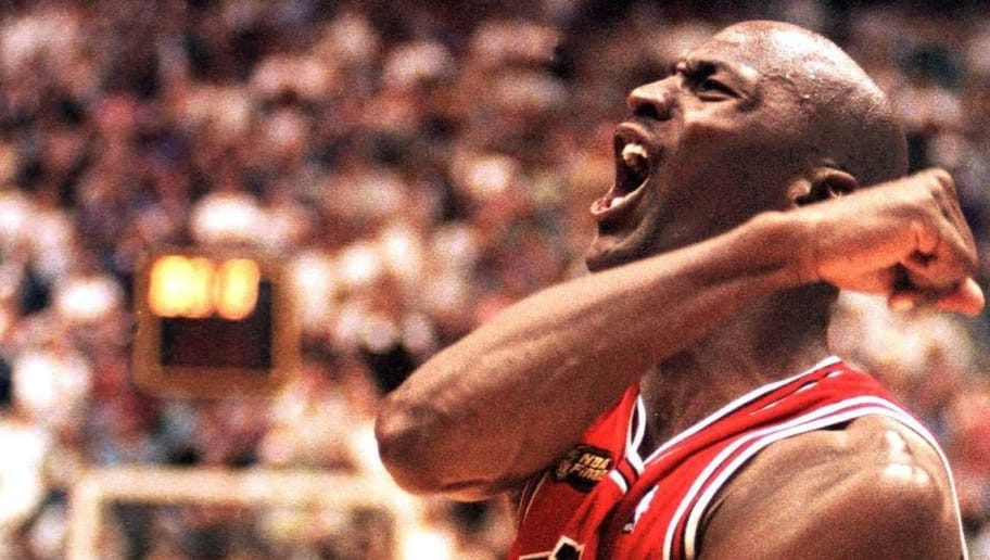 SALT LAKE CITY, UNITED STATES:  In this 14 June 1998 file photo, Michael Jordan of the Chicago Bulls celebrates after winning game six of the NBA Finals against the Utah Jazz at the Delta Center in Salt Lake City, UT. The win gave the Bulls their sixth NBA championship. It was reported by Fox Sports 31 March 1999 that Jordan, who announced his retirement 13 January 1999, is contemplating playing next season for the Charlotte Hornets, the National Basketball Association club in which Jordan is considering purchasing a 50 percent share. AFP PHOTO/FILES/Robert SULLIVAN (Photo credit should read ROBERT SULLIVAN/AFP/Getty Images)