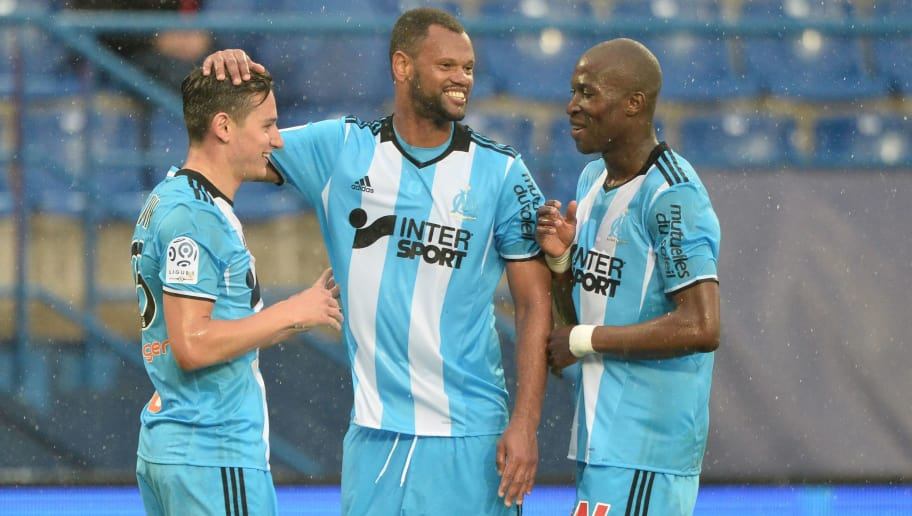 Olympique de Marseille's French midfielder Florian Thauvin (L) is congratulated by Olympique de Marseille's Portuguese defender Jorge Pires Da Fonseca Rolando (C) and Olympique de Marseille's French defender Rod Fanni after scoring during the French L1 football match between Caen (SMC) and Marseille (OM) on April 30, 2017, at the Michel-d'Ornano stadium in Caen, northwestern France.  / AFP PHOTO / JEAN-FRANCOIS MONIER        (Photo credit should read JEAN-FRANCOIS MONIER/AFP/Getty Images)
