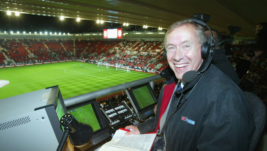 SOUTHAMPTON - OCTOBER 16:  Sky television commentator Martin Tyler in the commentary boxbefore the Euro 2004 Championship Qualifying match between England and Macedonia on October 16, 2002 at St. Mary's Stadium in Southampton, England. (Photo by Mike Hewitt/Getty Images)
