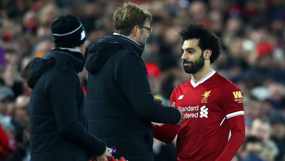 LIVERPOOL, ENGLAND - DECEMBER 30: Jurgen Klopp, Manager of Liverpool greets Mohamed Salah of Liverpool after he is substituted off during the Premier League match between Liverpool and Leicester City at Anfield on December 30, 2017 in Liverpool, England.  (Photo by Clive Brunskill/Getty Images)