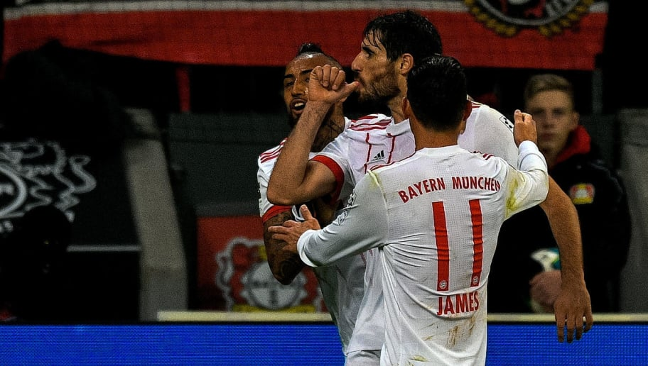 Bayern Munich's Spanish midfielder Javier Martinez (C) celebrates scoring the opening goal with his teamates during the German First division Bundesliga football match Bayer Leverkusen vs FC Bayern Munich on January 12, 2018 in Leverkusen, western Germany. / AFP PHOTO / SASCHA SCHUERMANN / RESTRICTIONS: DURING MATCH TIME: DFL RULES TO LIMIT THE ONLINE USAGE TO 15 PICTURES PER MATCH AND FORBID IMAGE SEQUENCES TO SIMULATE VIDEO. == RESTRICTED TO EDITORIAL USE == FOR FURTHER QUERIES PLEASE CONTACT DFL DIRECTLY AT + 49 69 650050         (Photo credit should read SASCHA SCHUERMANN/AFP/Getty Images)