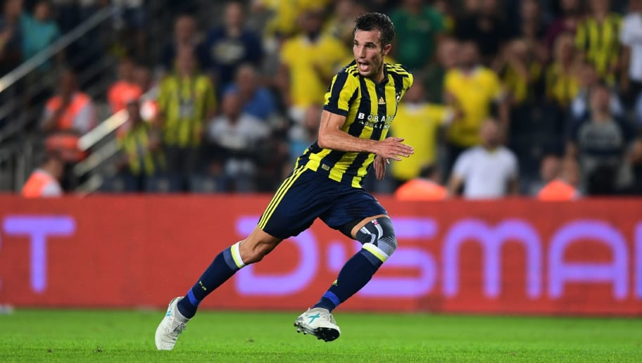 Fenerbahce's Dutch forward Robin Van Persie runs during the UEFA Europa League third qualifying round second match between Fenerbahce and Sturm Graz at Fenerbahce's Ulker Stadium in Istanbul on August 3, 2017. / AFP PHOTO / OZAN KOSE        (Photo credit should read OZAN KOSE/AFP/Getty Images)