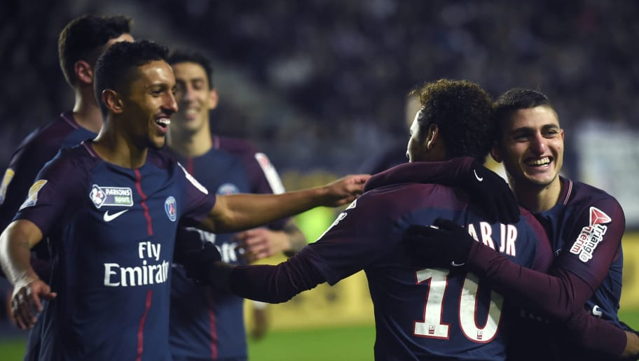 Paris Saint-Germain's Brazilian forward Neymar (2nd R) celebrates with teammates after scoring a penalty kick  during the French League Cup quarter-final football match between Amiens (ASC) and Paris Saint-Germain (PSG) at the Licorne Stadium in Amiens, northern France, on January 10, 2018. / AFP PHOTO / FRANCOIS LO PRESTI        (Photo credit should read FRANCOIS LO PRESTI/AFP/Getty Images)