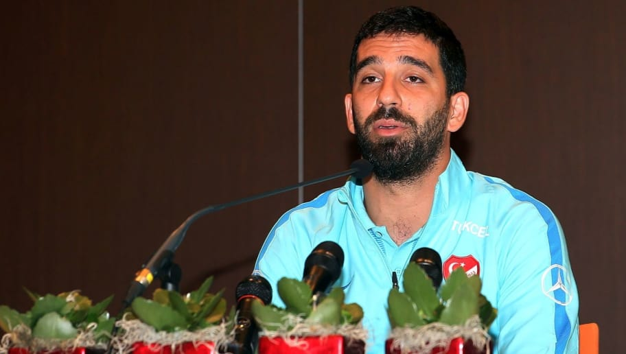 Barcelona's Turkish midfielder and Turkey's captain Arda Turan addresses a press conference announcing his retirement from international football in Portoroz, Slovenia, on June 6, 2017. Turan announced his retirement from international football on Tuesday, hours after being kicked out of a training camp by coach Fatih Terim for allegedly verbally and physically abusing a journalist. Turan had been told to leave the Turkey team's camp in Slovenia where they are preparing for a 2018 World Cup qualifier against Kosovo on June 11, the daily Hürriyet and news channel NTV earlier reported. / AFP PHOTO / STR        (Photo credit should read STR/AFP/Getty Images)