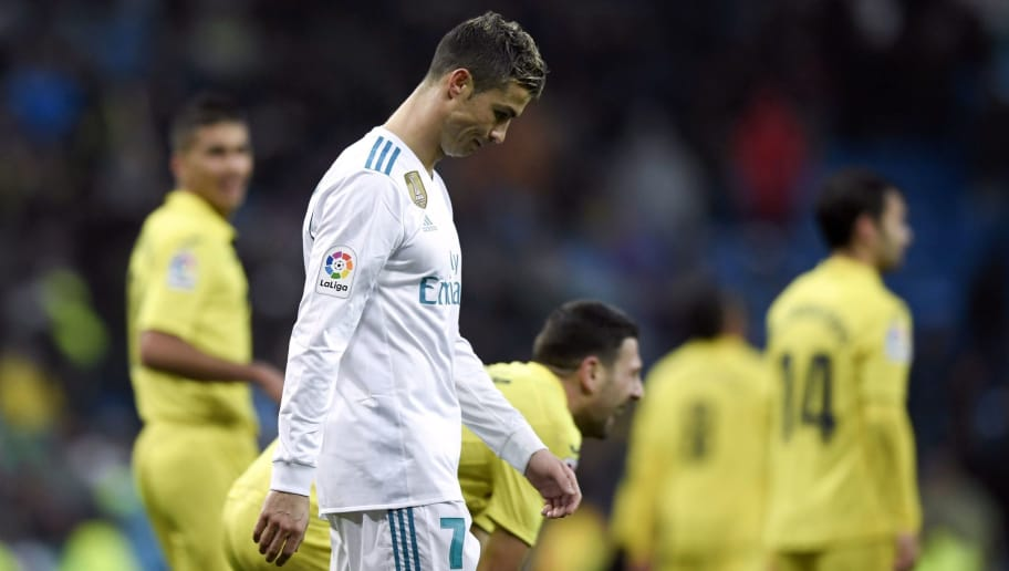 Real Madrid's Portuguese forward Cristiano Ronaldo reacts at the end of the Spanish league football match between Real Madrid and Villarreal at the Santiago Bernabeu Stadium in Madrid on January 13, 2018. / AFP PHOTO / GABRIEL BOUYS        (Photo credit should read GABRIEL BOUYS/AFP/Getty Images)