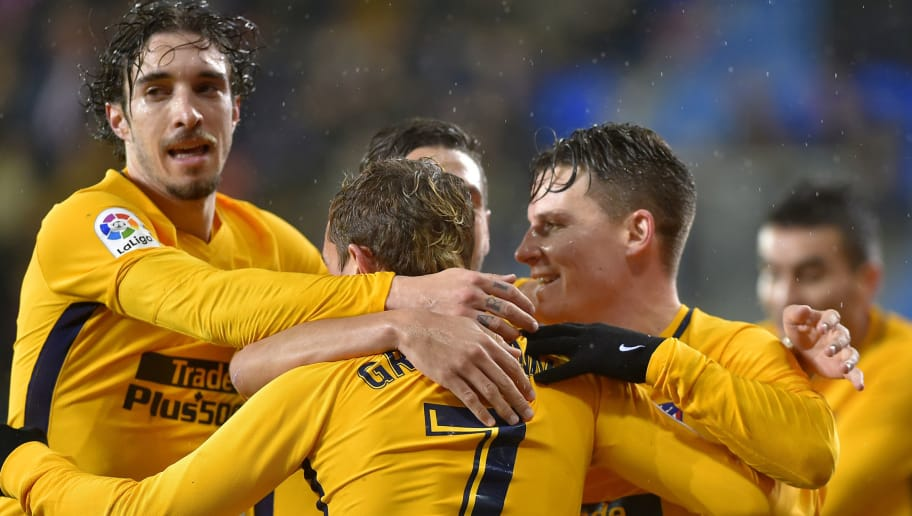 Atletico Madrid players celebrate after French forward Kevin Gameiro (R) scored his team's first goal during the Spanish league football match between SD Eibar and Club Atletico de Madrid at the Ipurua stadium in Eibar on January 13, 2018. / AFP PHOTO / ANDER GILLENEA        (Photo credit should read ANDER GILLENEA/AFP/Getty Images)
