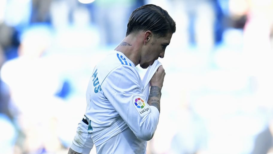 Real Madrid's Spanish defender Sergio Ramos reacts during the Spanish League 'Clasico' football match Real Madrid CF vs FC Barcelona at the Santiago Bernabeu stadium in Madrid on December 23, 2017.  / AFP PHOTO / JAVIER SORIANO        (Photo credit should read JAVIER SORIANO/AFP/Getty Images)