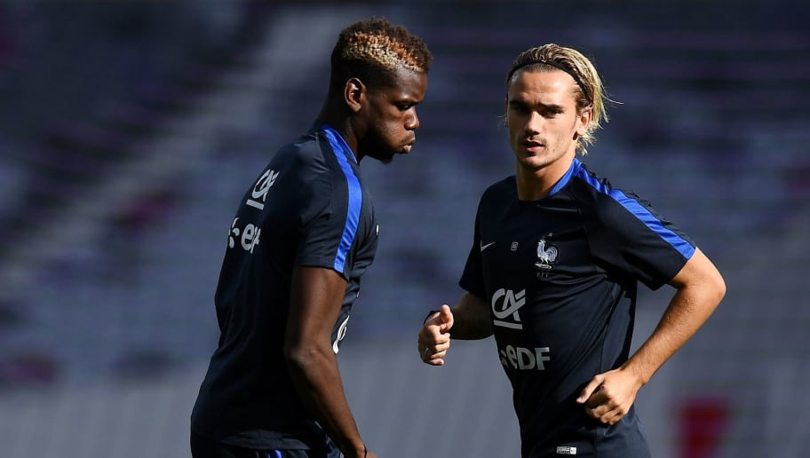 France's forward Antoine Griezmann (R) and France's midfielder Paul Pogba take part in a training session at the Municipal Stadium in Toulouse southern France, on September 2, 2017, on the eve of the FIFA World Cup 2018 qualifying football match against Luxembourg.  / AFP PHOTO / FRANCK FIFE        (Photo credit should read FRANCK FIFE/AFP/Getty Images)