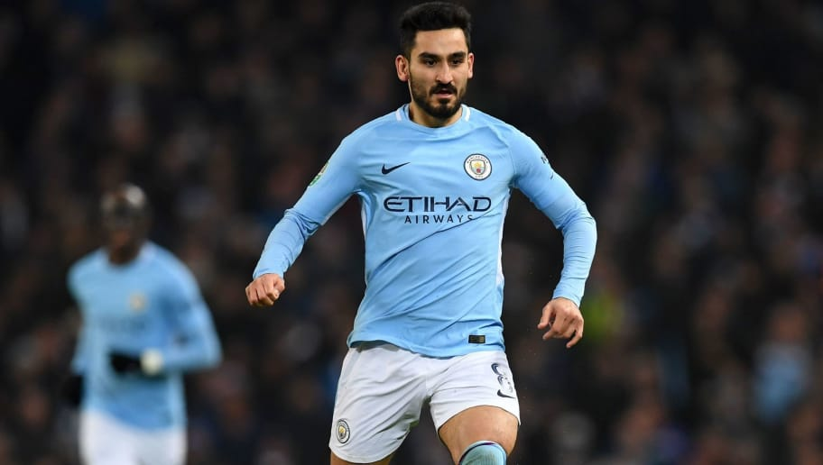 Manchester City's German midfielder Ilkay Gundogan runs with the ball during the English League Cup semi-final first leg football match between Manchester City and Bristol City at the Etihad Stadium in Manchester, north west England, on January 9, 2018. / AFP PHOTO / Paul ELLIS / RESTRICTED TO EDITORIAL USE. No use with unauthorized audio, video, data, fixture lists, club/league logos or 'live' services. Online in-match use limited to 75 images, no video emulation. No use in betting, games or single club/league/player publications.  /         (Photo credit should read PAUL ELLIS/AFP/Getty Images)