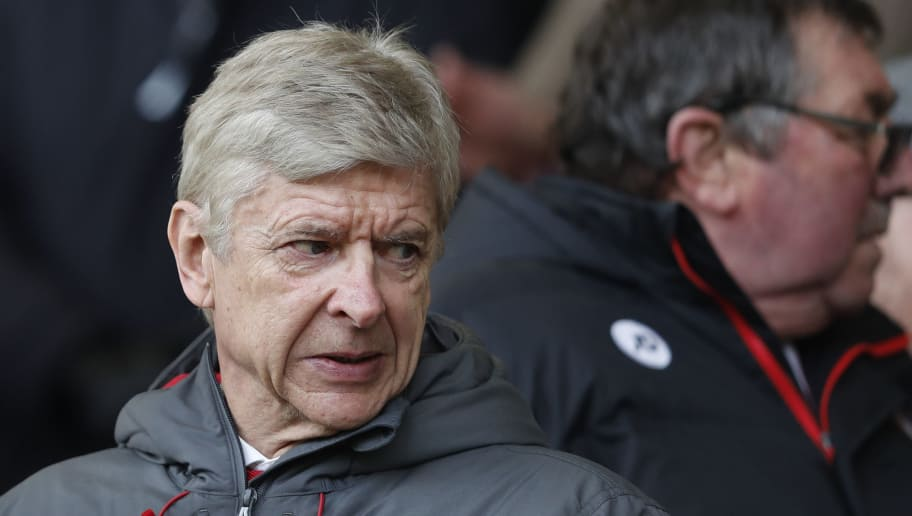 Arsenal's French manager Arsene Wenger looks on from the stands before the English Premier League football match between Bournemouth and Arsenal at the Vitality Stadium in Bournemouth, southern England on January 14, 2018. / AFP PHOTO / Adrian DENNIS / RESTRICTED TO EDITORIAL USE. No use with unauthorized audio, video, data, fixture lists, club/league logos or 'live' services. Online in-match use limited to 75 images, no video emulation. No use in betting, games or single club/league/player publications.  /         (Photo credit should read ADRIAN DENNIS/AFP/Getty Images)