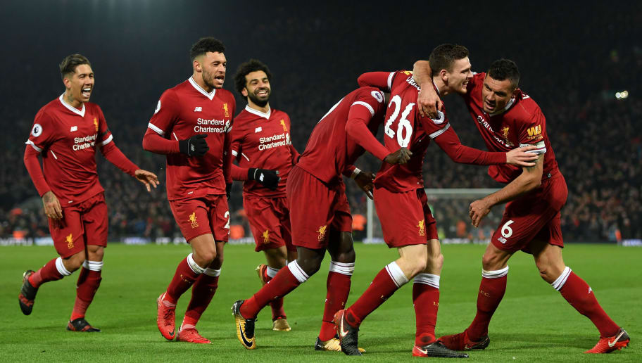LIVERPOOL, ENGLAND - JANUARY 14:  Sadio Mane of Liverpool celebrates with team mates after scoring the third Liverpool goal during the Premier League match between Liverpool and Manchester City at Anfield on January 14, 2018 in Liverpool, England.  (Photo by Shaun Botterill/Getty Images)