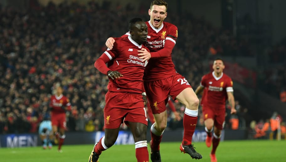 LIVERPOOL, ENGLAND - JANUARY 14:  Sadio Mane of Liverpool celebrates with team mate Andy Robertson after scoring the third Liverpool goal during the Premier League match between Liverpool and Manchester City at Anfield on January 14, 2018 in Liverpool, England.  (Photo by Shaun Botterill/Getty Images)