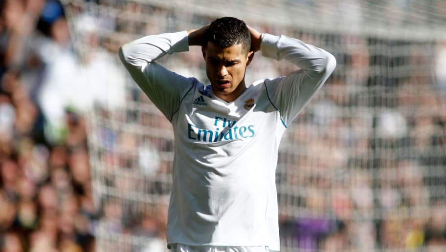 Real Madrid's Portuguese forward Cristiano Ronaldo reacts during the Spanish League 'Clasico' football match Real Madrid CF vs FC Barcelona at the Santiago Bernabeu stadium in Madrid on December 23, 2017.  / AFP PHOTO / OSCAR DEL POZO        (Photo credit should read OSCAR DEL POZO/AFP/Getty Images)