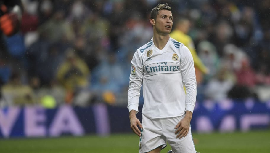 Real Madrid's Portuguese forward Cristiano Ronaldo reacts after missing a goal opportunity during the Spanish league football match between Real Madrid and Villarreal at the Santiago Bernabeu Stadium in Madrid on January 13, 2018. / AFP PHOTO / GABRIEL BOUYS        (Photo credit should read GABRIEL BOUYS/AFP/Getty Images)