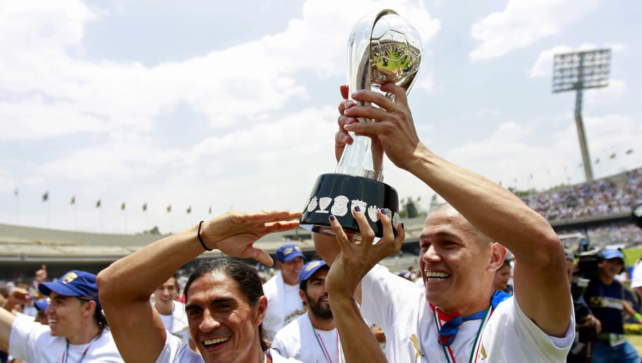 MEXICO CITY, MEXICO - MAY 22: Juan Francisco Palencia and Dario Veron of Pumas celebrate their championship title after defeating Morelia in a final match as part of the Clausura Tournament 2011 at Olimpico Stadium on May 22, 2011 in Mexico City, Mexico. (Photo by Daniel Cardenas/Latincontent/GettyImages)