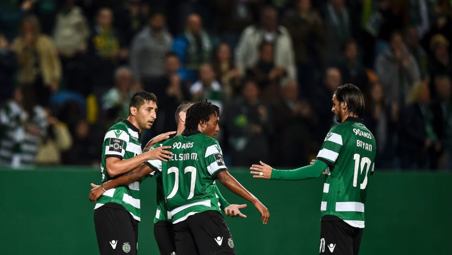 Sporting's Argentine midfielder Alan Ruiz (L) celebrates with teammates after scoring during the Portuguese league football match Sporting CP vs Vitoria Guimaraes SC at the Jose Alvalade stadium in Lisbon on March 5, 2017. / AFP PHOTO / PATRICIA DE MELO MOREIRA        (Photo credit should read PATRICIA DE MELO MOREIRA/AFP/Getty Images)