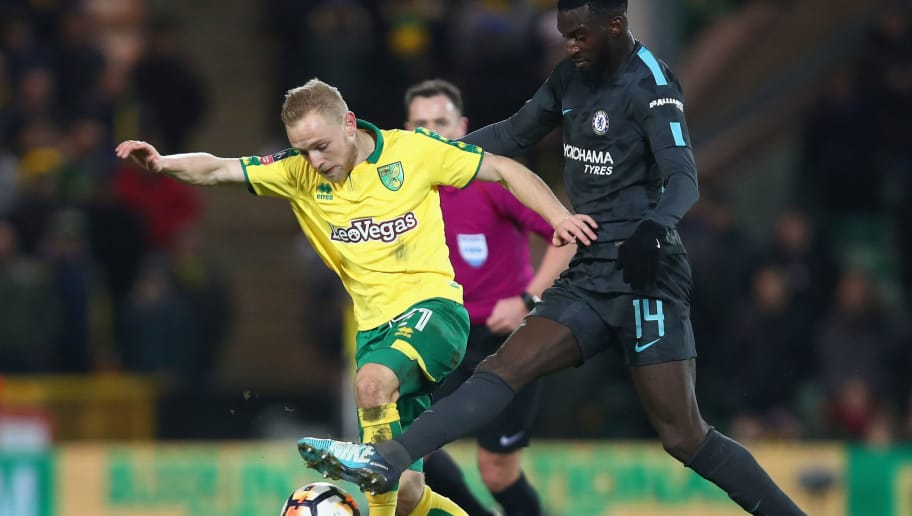 NORWICH, ENGLAND - JANUARY 06: Alex Pritchard of Norwich City is challenged by Tiemoue Bakayoko of Chelsea during the The Emirates FA Cup Third Round match between Norwich City and Chelsea at Carrow Road on January 6, 2018 in Norwich, England.  (Photo by James Chance/Getty Images)
