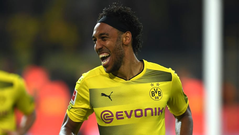 Dortmund's Gabonese striker Pierre-Emerick Aubameyang celebrates scoring during the German First division Bundesliga football match Borussia Dortmund  vs Borussia Moenchengladbach in Dortmund, western Germany, on September 23, 2017. / AFP PHOTO / PATRIK STOLLARZ        (Photo credit should read PATRIK STOLLARZ/AFP/Getty Images)