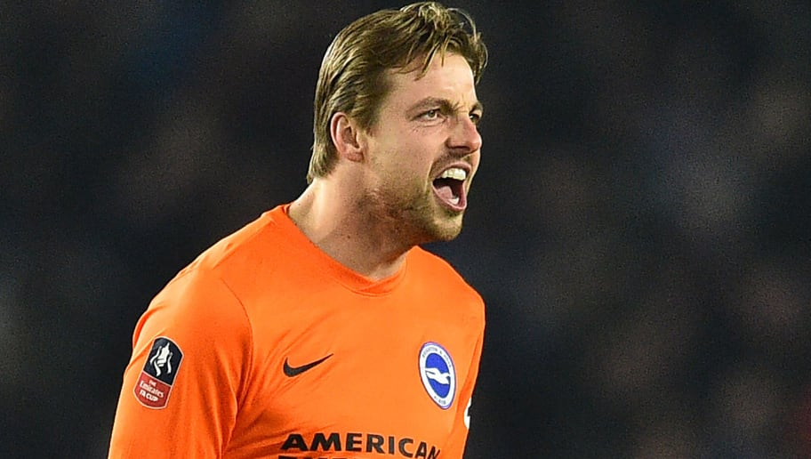 Brighton's Dutch goalkeeper Tim Krul reacts during the English FA Cup third round football match between Brighton and Hove Albion and Crystal Palace at the American Express Community Stadium in Brighton, southern England on January 8, 2018. / AFP PHOTO / Glyn KIRK / RESTRICTED TO EDITORIAL USE. No use with unauthorized audio, video, data, fixture lists, club/league logos or 'live' services. Online in-match use limited to 75 images, no video emulation. No use in betting, games or single club/league/player publications.  /         (Photo credit should read GLYN KIRK/AFP/Getty Images)