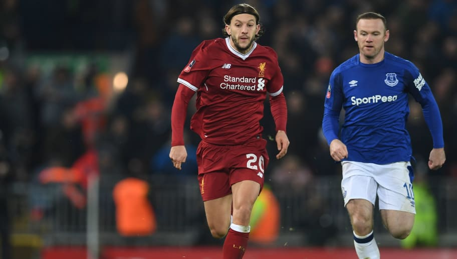 Liverpool's English midfielder Adam Lallana (L) runs away from Everton's English striker Wayne Rooney (R) during the English FA Cup third round football match between Liverpool and Everton at Anfield in Liverpool, north west England on January 5, 2018. / AFP PHOTO / Paul ELLIS / RESTRICTED TO EDITORIAL USE. No use with unauthorized audio, video, data, fixture lists, club/league logos or 'live' services. Online in-match use limited to 75 images, no video emulation. No use in betting, games or single club/league/player publications.  /         (Photo credit should read PAUL ELLIS/AFP/Getty Images)