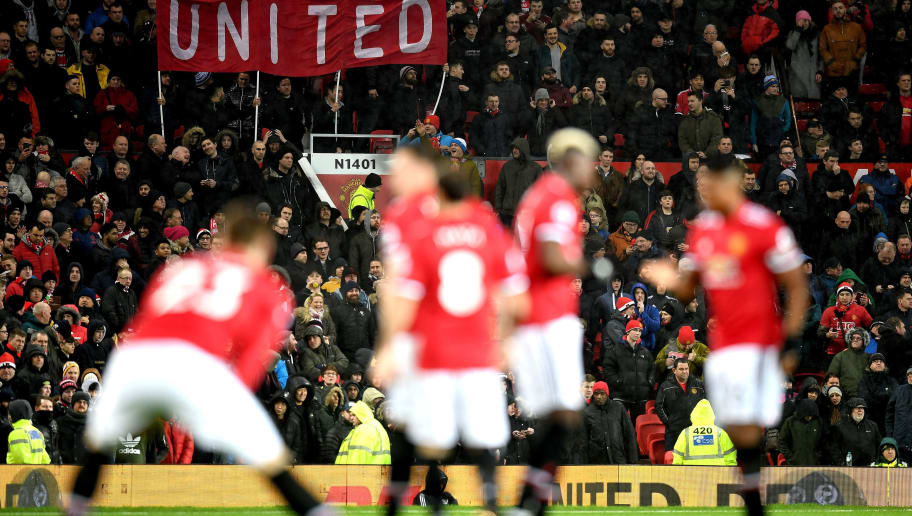 MANCHESTER, ENGLAND - JANUARY 15:  Fans show their support as the players make their way out onto the pitch prior to the Premier League match between Manchester United and Stoke City at Old Trafford on January 15, 2018 in Manchester, England.  (Photo by Michael Regan/Getty Images)