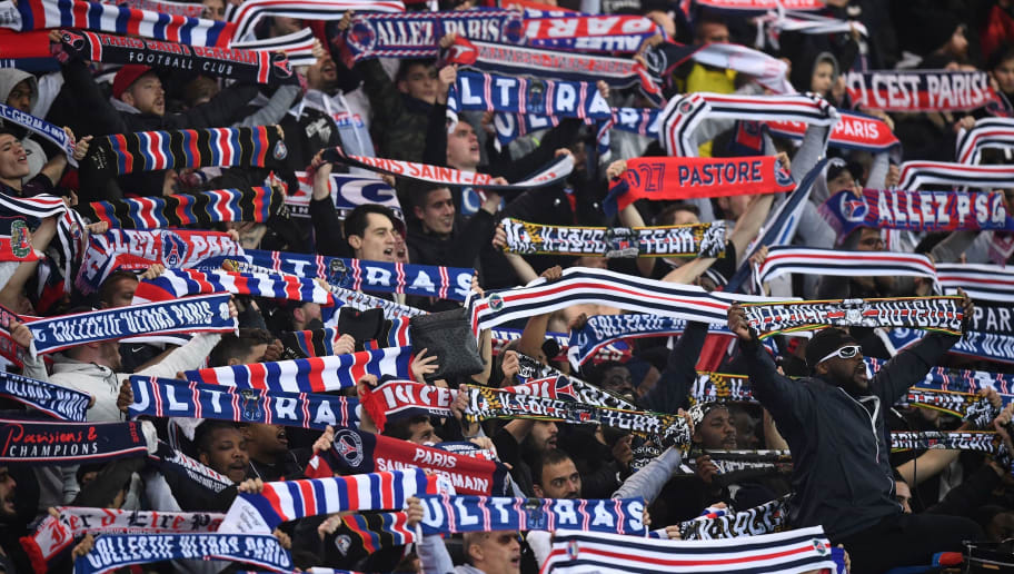 Paris Saint-Germain's supporters react during the French L1 football match between Paris Saint-Germain and Caen at the Parc des Princes stadium in Paris on December 20, 2017.    / AFP PHOTO / FRANCK FIFE        (Photo credit should read FRANCK FIFE/AFP/Getty Images)