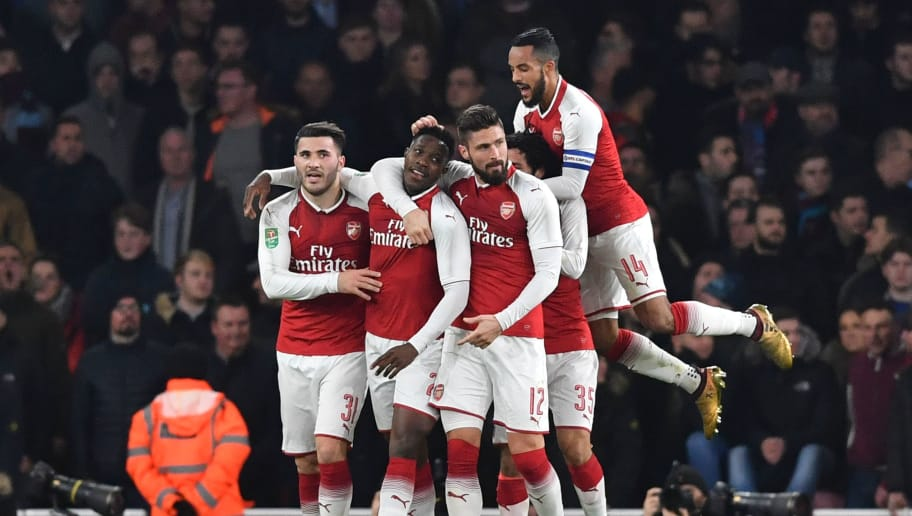 Arsenal's English striker Danny Welbeck (2L) celebrates scoring the opening goal with team-mates Arsenal's German-born Bosnian defender Sead Kolasinac (L), Arsenal's French striker Olivier Giroud (3R) and Arsenal's English midfielder Theo Walcott (R) during the English League Cup quarter-final football match between Arsenal and West Ham United at the Emirates Stadium in London on December 19, 2017.  / AFP PHOTO / Ben STANSALL / RESTRICTED TO EDITORIAL USE. No use with unauthorized audio, video, data, fixture lists, club/league logos or 'live' services. Online in-match use limited to 75 images, no video emulation. No use in betting, games or single club/league/player publications.  /         (Photo credit should read BEN STANSALL/AFP/Getty Images)