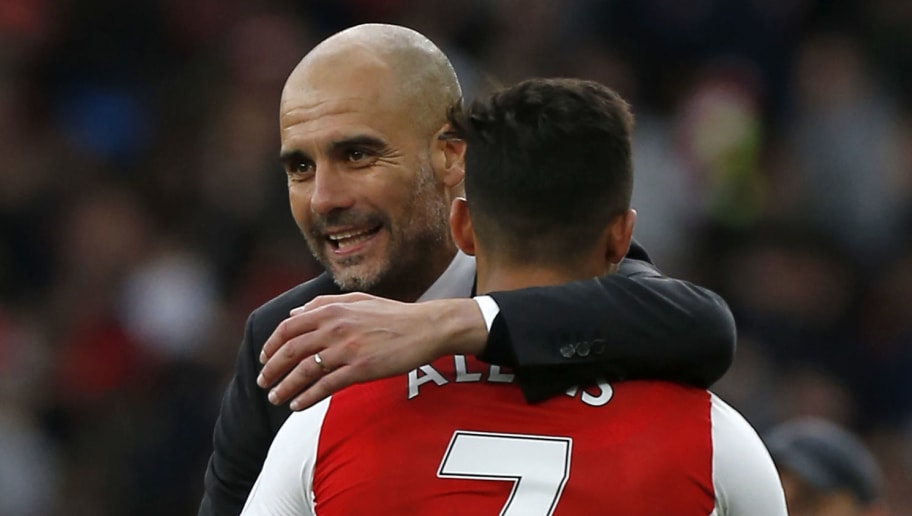 Manchester City's Spanish manager Pep Guardiola embraces Arsenal's Chilean striker Alexis Sanchez on the pitch after the English Premier League football match between Arsenal and Manchester City at The Emirates in London, on April 2, 2017. The game finished 2-2. / AFP PHOTO / IKIMAGES / Ian KINGTON / RESTRICTED TO EDITORIAL USE. No use with unauthorized audio, video, data, fixture lists, club/league logos or 'live' services. Online in-match use limited to 45 images, no video emulation. No use in betting, games or single club/league/player publications.        (Photo credit should read IAN KINGTON/AFP/Getty Images)
