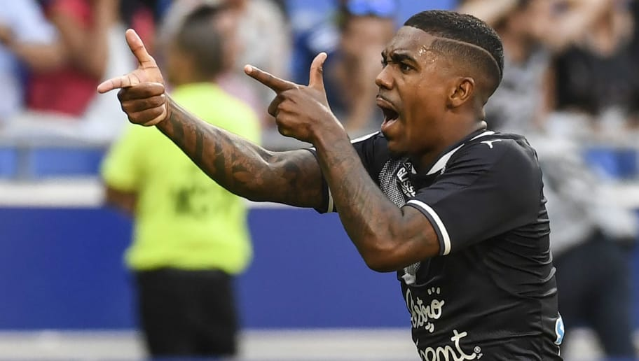 Bordeaux's Brazilian forward Malcom celebrates after scoring a goal during the L1 football match Olympique Lyonnais (OL) vs FC Girondins de Bordeaux (FCGB), on August 19, 2017 at the Groupama stadium in Décines-Charpieu near Lyon, southeastern France. / AFP PHOTO / PHILIPPE DESMAZES        (Photo credit should read PHILIPPE DESMAZES/AFP/Getty Images)