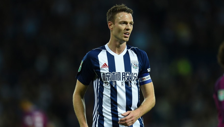 West Bromwich Albion's Northern Irish defender Jonny Evans is pictured during the English League Cup third round football match between West Bromwich Albion and Manchester City at The Hawthorns in West Bromwich, central England September 20, 2017. / AFP PHOTO / Oli SCARFF / RESTRICTED TO EDITORIAL USE. No use with unauthorized audio, video, data, fixture lists, club/league logos or 'live' services. Online in-match use limited to 75 images, no video emulation. No use in betting, games or single club/league/player publications.  /         (Photo credit should read OLI SCARFF/AFP/Getty Images)