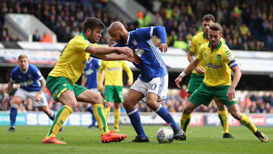 IPSWICH, ENGLAND - OCTOBER 22:  David McGoldrick of Ipswich and Grant Hanley of Norwich City battle for possession during the Sky Bet Championship match between Ipswich Town and Norwich City at Portman Road on October 22, 2017 in Ipswich, England.  (Photo by Dan Istitene/Getty Images)