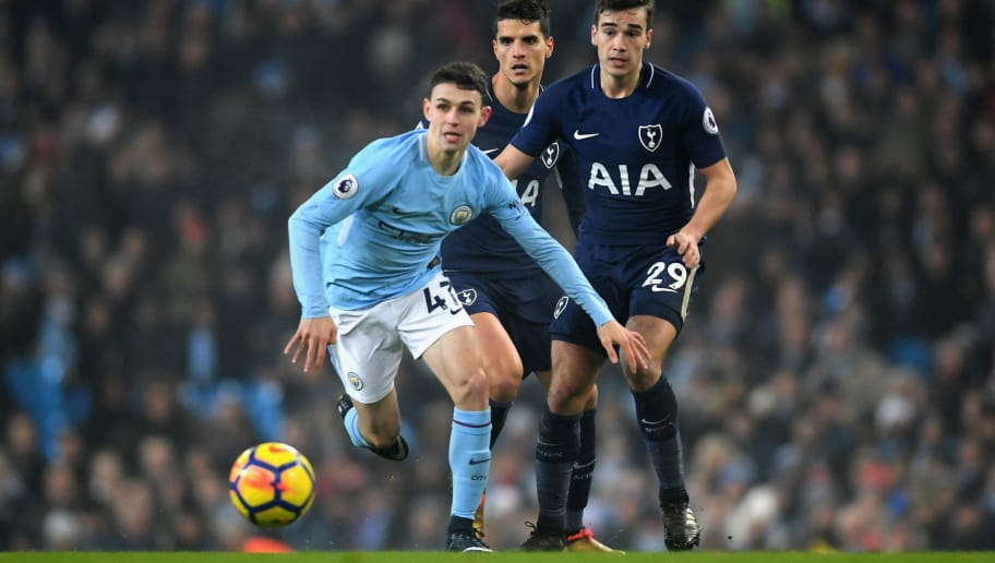 MANCHESTER, ENGLAND - DECEMBER 16: Phil Foden of Manchester City runs with the ball during the Premier League match between Manchester City and Tottenham Hotspur at Etihad Stadium on December 16, 2017 in Manchester, England.  (Photo by Laurence Griffiths/Getty Images)