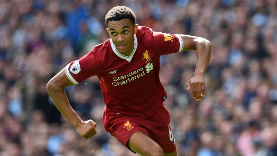 Liverpool's English midfielder Trent Alexander-Arnold runs with the ball during the English Premier League football match between Manchester City and Liverpool at the Etihad Stadium in Manchester, north west England, on September 9, 2017. / AFP PHOTO / Paul ELLIS / RESTRICTED TO EDITORIAL USE. No use with unauthorized audio, video, data, fixture lists, club/league logos or 'live' services. Online in-match use limited to 75 images, no video emulation. No use in betting, games or single club/league/player publications.  /         (Photo credit should read PAUL ELLIS/AFP/Getty Images)