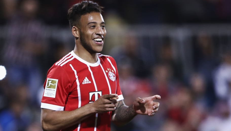DOHA, QATAR - JANUARY 06: Corentin Tolisso of Muenchen celebrates his team's second goal during the friendly match between Al-Ahli and Bayern Muenchen on day 5 of the FC Bayern Muenchen training camp at ASPIRE Academy for Sports Excellence on January 6, 2018 in Doha, Qatar.  (Photo by Alex Grimm/Bongarts/Getty Images)