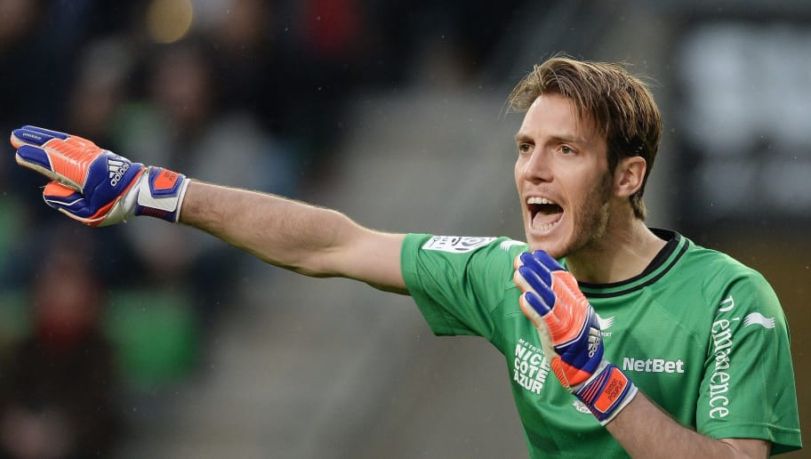 Nice's French goalkeeper Simon Pouplin shouts instructions during the French L1 football match between Rennes (SR) and Nice (OGCN) on April 25, 2015 at the Route de Lorient stadium in Rennes, western France. AFP PHOTO / JEAN-SEBASTIEN EVRARD        (Photo credit should read JEAN-SEBASTIEN EVRARD/AFP/Getty Images)