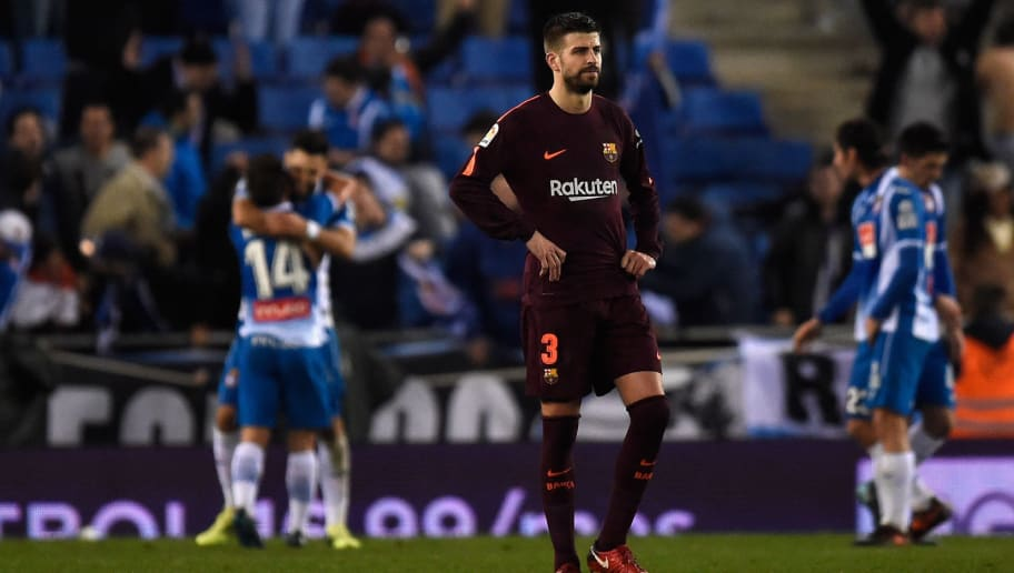 BARCELONA, SPAIN - JANUARY 17:  Gerard Pique of Barcelona looks dejected after Espanyol score their first goal during the Spanish Copa del Rey Quarter Final First Leg match between Espanyol and Barcelona at Nuevo Estadio de Cornella-El Prat on January 17, 2018 in Barcelona, Spain.  (Photo by Alex Caparros/Getty Images)
