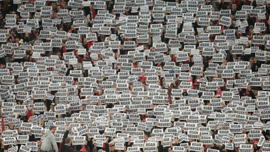 RESTRICTIONS / EMBARGO - ONLINE CLIENTS MAY USE UP TO SIX IMAGES DURING EACH MATCH WITHOUT THE AUTHORISATION OF THE DFB. NO MOBILE USE DURING THE MATCH AND FOR A FURTHER TWO HOURS AFTERWARDS IS PERMITTED WITHOUT THE AUTHORISATION OF THE GERMAN FOOTBALL FEDERATION DFB.Munich's fans hold up posters reading 'Koan Neuer' (No New/Neuer) to express their protest against Schalke's goalkeeper Manuel Neuer to change to Bayern Munich during the German Cup semi-final football match of FC Bayern Munich against Schalke 04 on March 2, 2011 in Munich, southern Germany.    AFP PHOTO    CHRISTOF STACHE (Photo credit should read CHRISTOF STACHE/AFP/Getty Images)