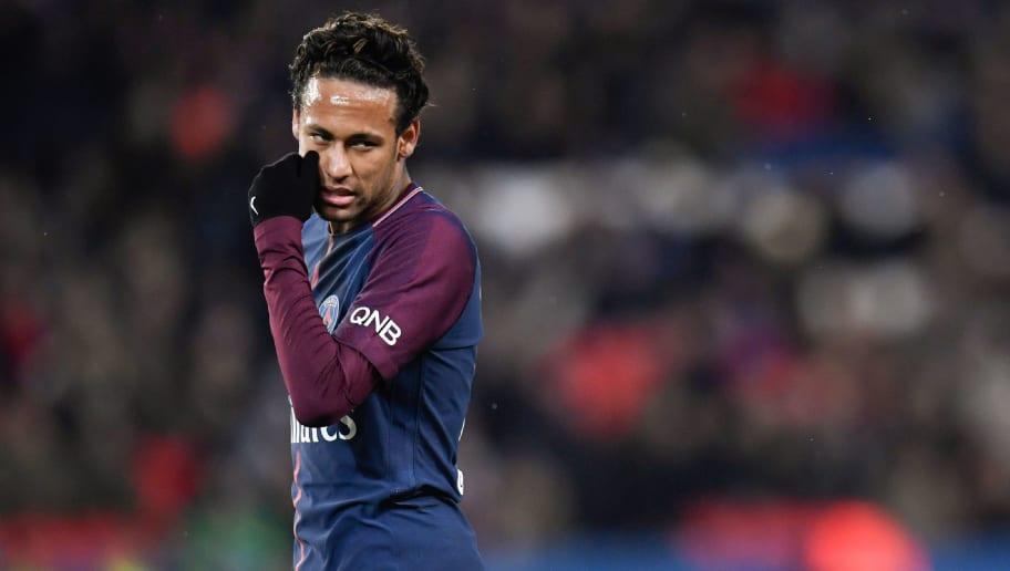 Paris Saint-Germain's Brazilian forward Neymar talks during the French L1 football match between Paris Saint-German and Dijon on January 17, 2018 at the Parc des Princes stadium in Paris. / AFP PHOTO / CHRISTOPHE SIMON / ALTERNATIVE CROP         (Photo credit should read CHRISTOPHE SIMON/AFP/Getty Images)