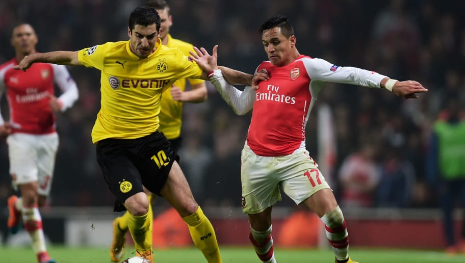 LONDON, ENGLAND - NOVEMBER 26:  Henrikh Mkhitaryan of Borussia Dortmund and Alexis Sanchez of Arsenal battle for the ball during the UEFA Champions League Group D match between Arsenal and Borussia Dortmund at the Emirates Stadium on November 26, 2014 in London, United Kingdom.  (Photo by Jamie McDonald/Getty Images)