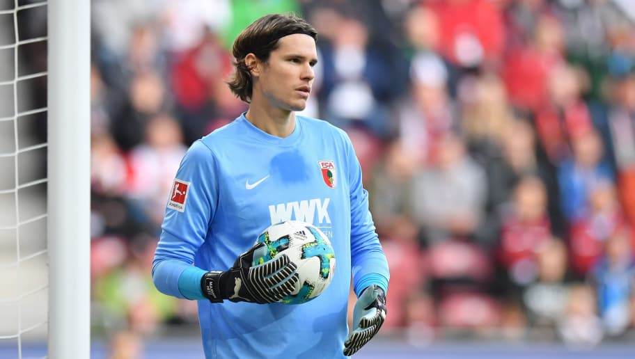 AUGSBURG, GERMANY - NOVEMBER 04: Goalkeeper Marwin Hitz of Augsburg holds the ball during the Bundesliga match between FC Augsburg and Bayer 04 Leverkusen at WWK-Arena on November 4, 2017 in Augsburg, Germany. (Photo by Sebastian Widmann/Bongarts/Getty Images)