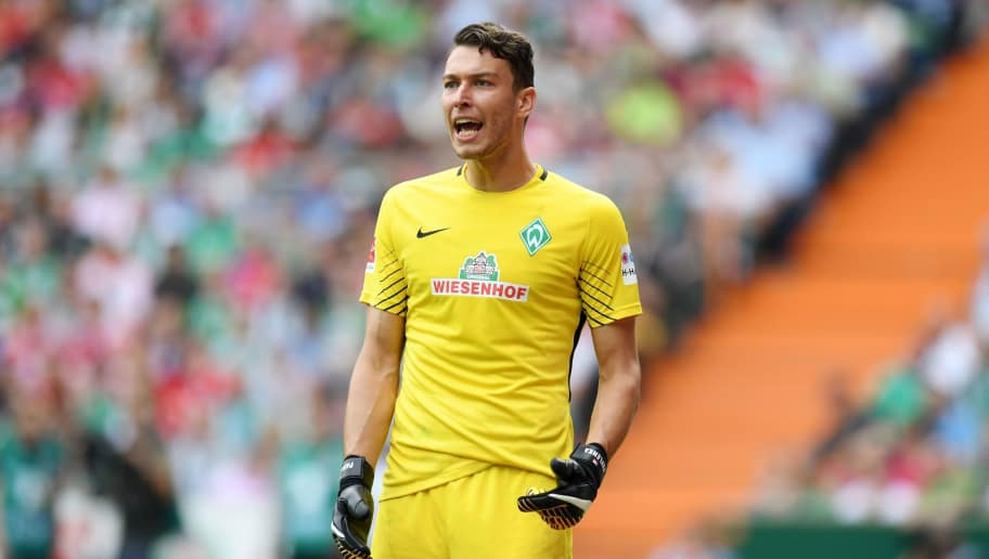 Bremen's Czech goalkeeper Jiri Pavlenka reacts during the German First division Bundesliga football match between Werder Bremen and Bayern Munich in Bremen, northern Germany, on August 26, 2017. / AFP PHOTO / PATRIK STOLLARZ / RESTRICTIONS: DURING MATCH TIME: DFL RULES TO LIMIT THE ONLINE USAGE TO 15 PICTURES PER MATCH AND FORBID IMAGE SEQUENCES TO SIMULATE VIDEO. == RESTRICTED TO EDITORIAL USE == FOR FURTHER QUERIES PLEASE CONTACT DFL DIRECTLY AT + 49 69 650050         (Photo credit should read PATRIK STOLLARZ/AFP/Getty Images)